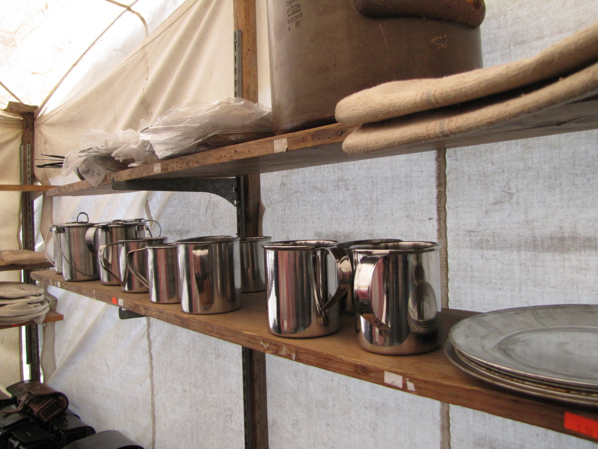 Shelves in a suttler's tent displaying plates and tin cups for soldiers. Photo taken at the March 2015 re-enactment of the Battle of Narcoosie Mill in St Cloud, Florida.