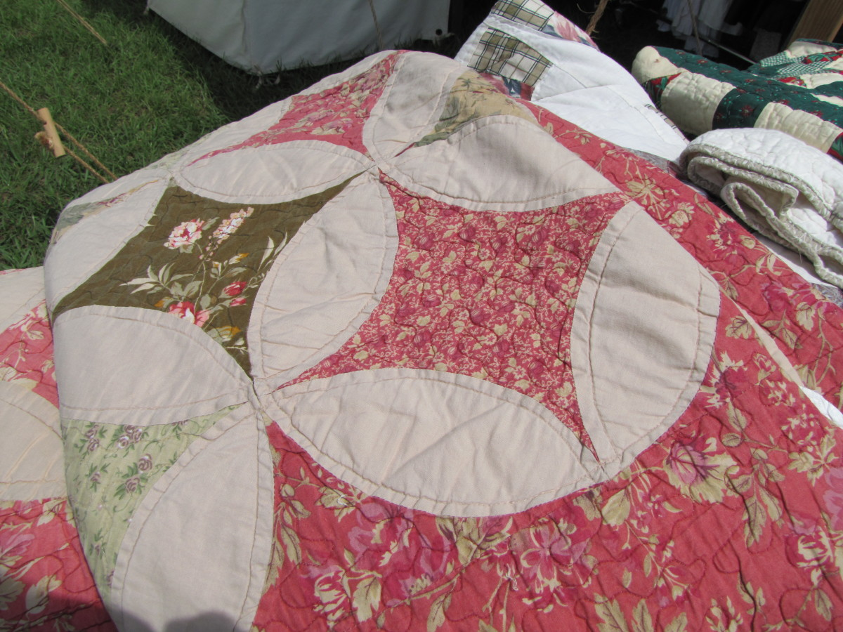 It is unlikely that a soldier would carry a heavy quilt along on the march. More likely a quilt such as this would have been used while the troops were in winter camp.