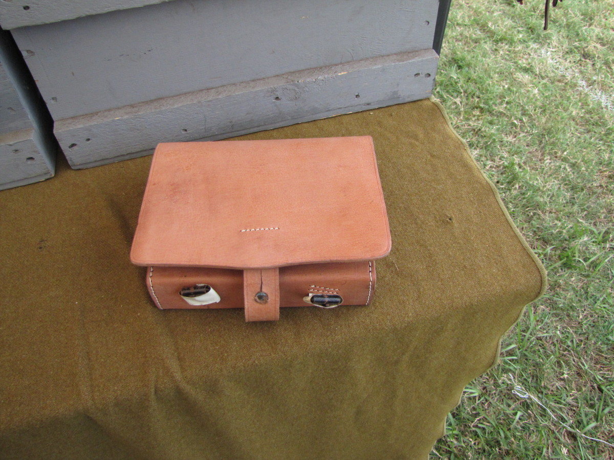 Civil War re-enactors can get handmade leather replicas to use. This one contained several tin lined compartments which I think would hold gunpowder or bullets.