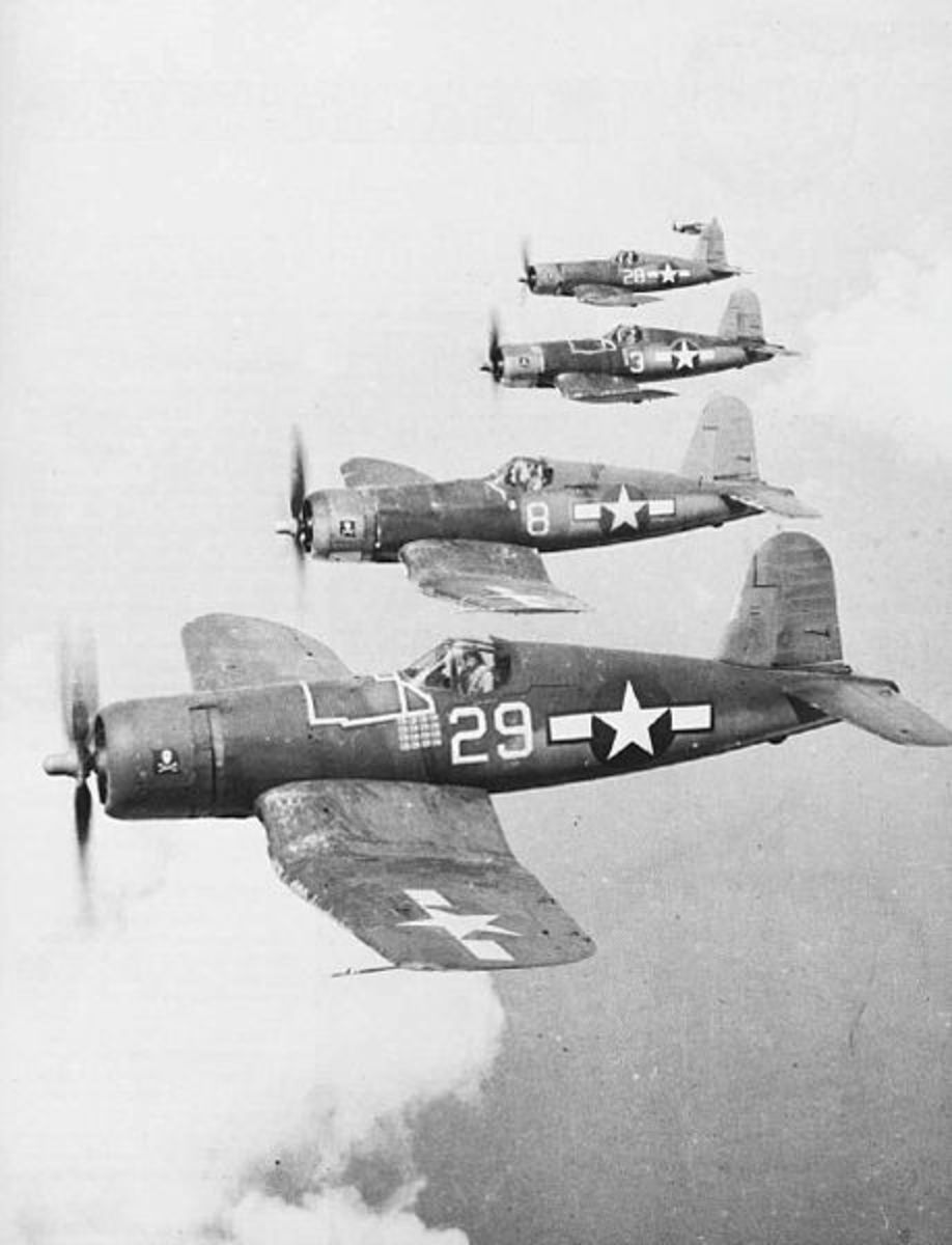 This is a photo of four F4U-1As.  In the Solomons of WWII, the Black Sheep had no assigned planes. Boyington was photographed with F4U-1A Corsair 18086 for the news.