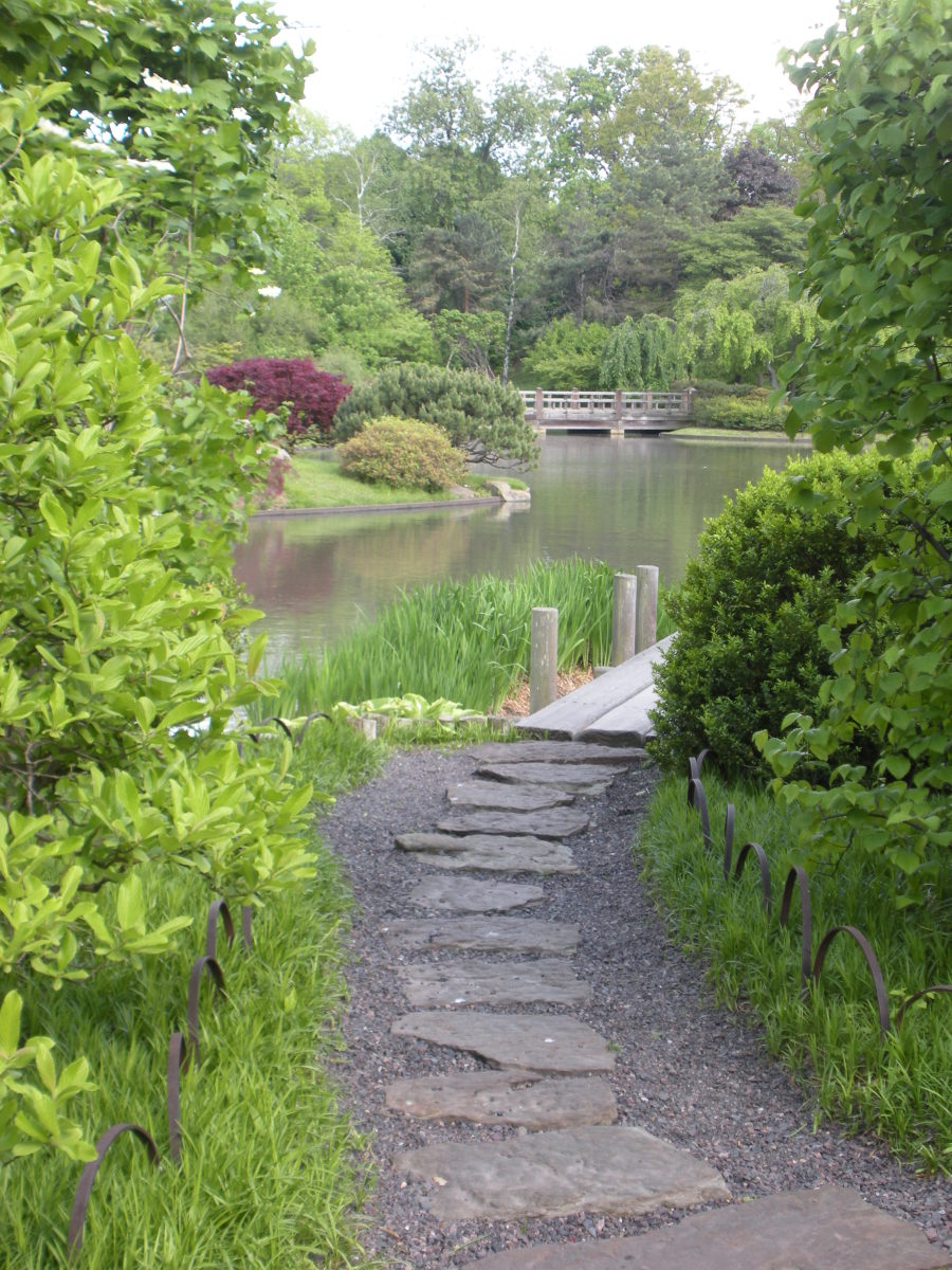 I love this path, its really two paths in one!  Large flat stepping stones among gravel, leaving to a wooden path next to a pond.