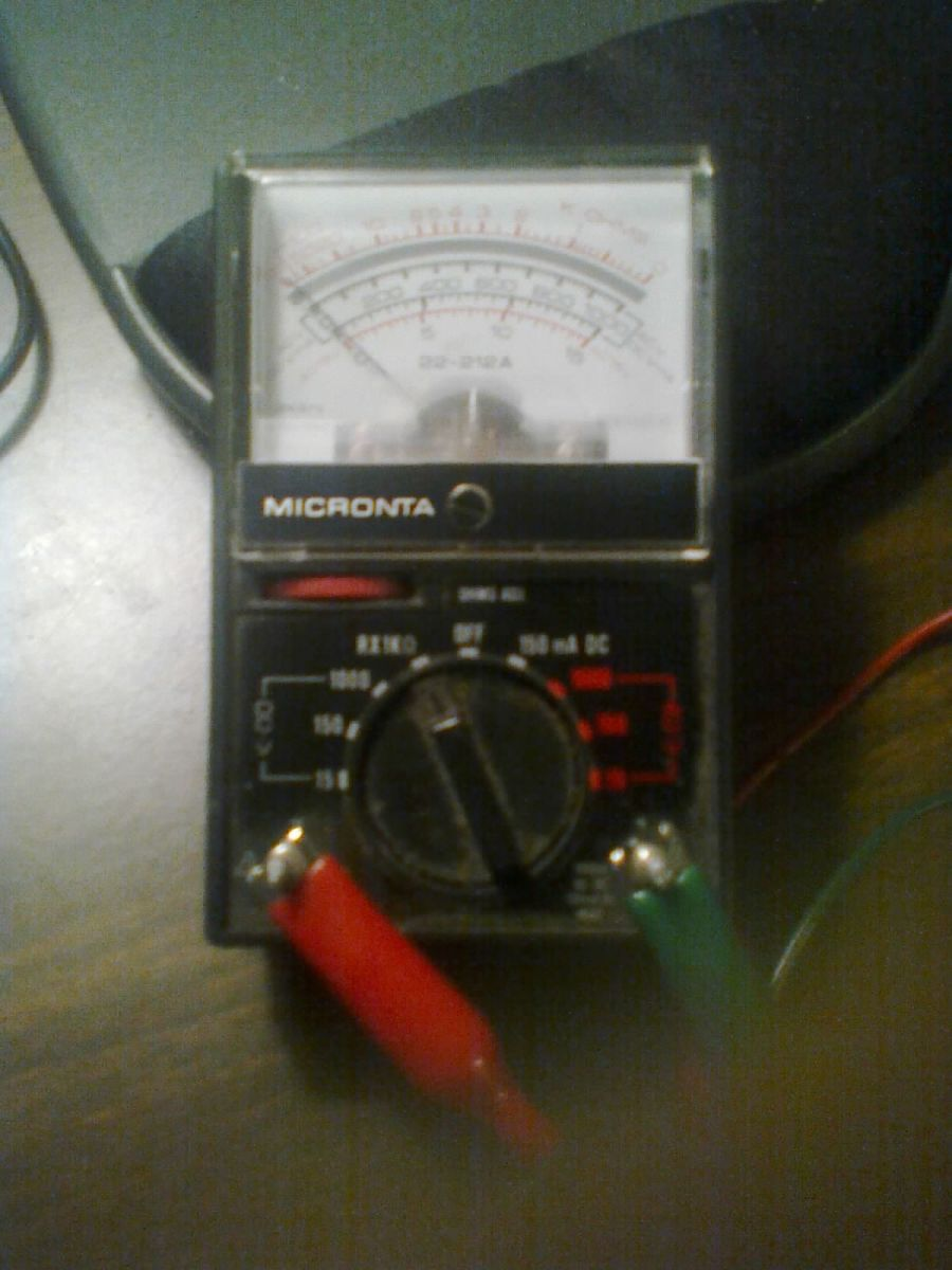 how-to-use-a-voltmeter-to-test-batteries-phone-jacks-printer-cables-and-more