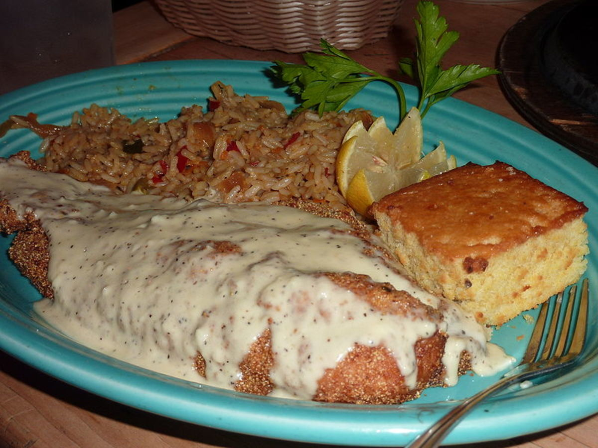 Tuscaloosa Catfish served with corn bread and rice