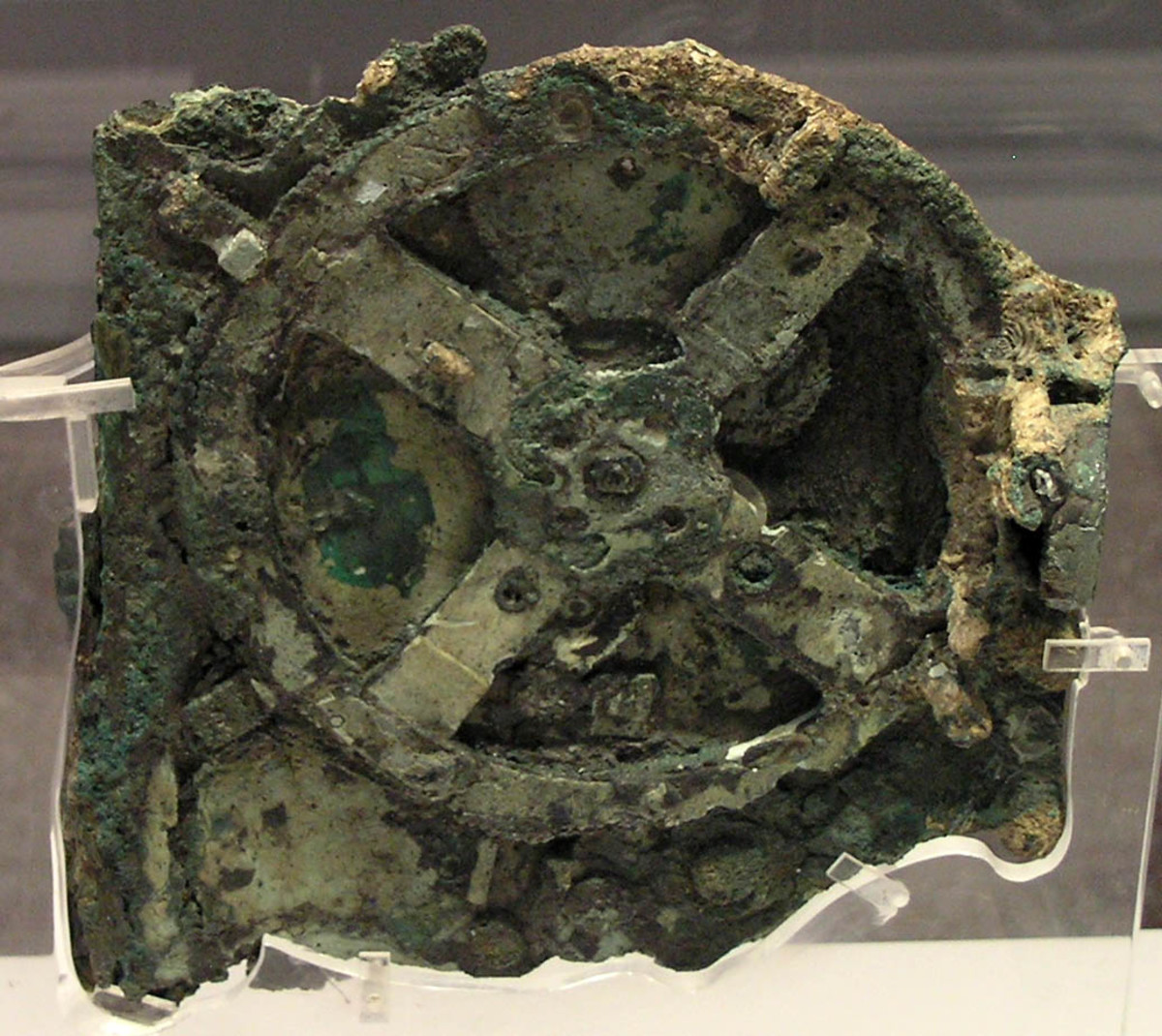 Antikythera mechanism fragment. The mechanism consists of a complex system of 32 wheels and plates with inscriptions relating to the signs of the zodiac and the months.  It is thought that this was a kind of astrolabe used for marine navigation.