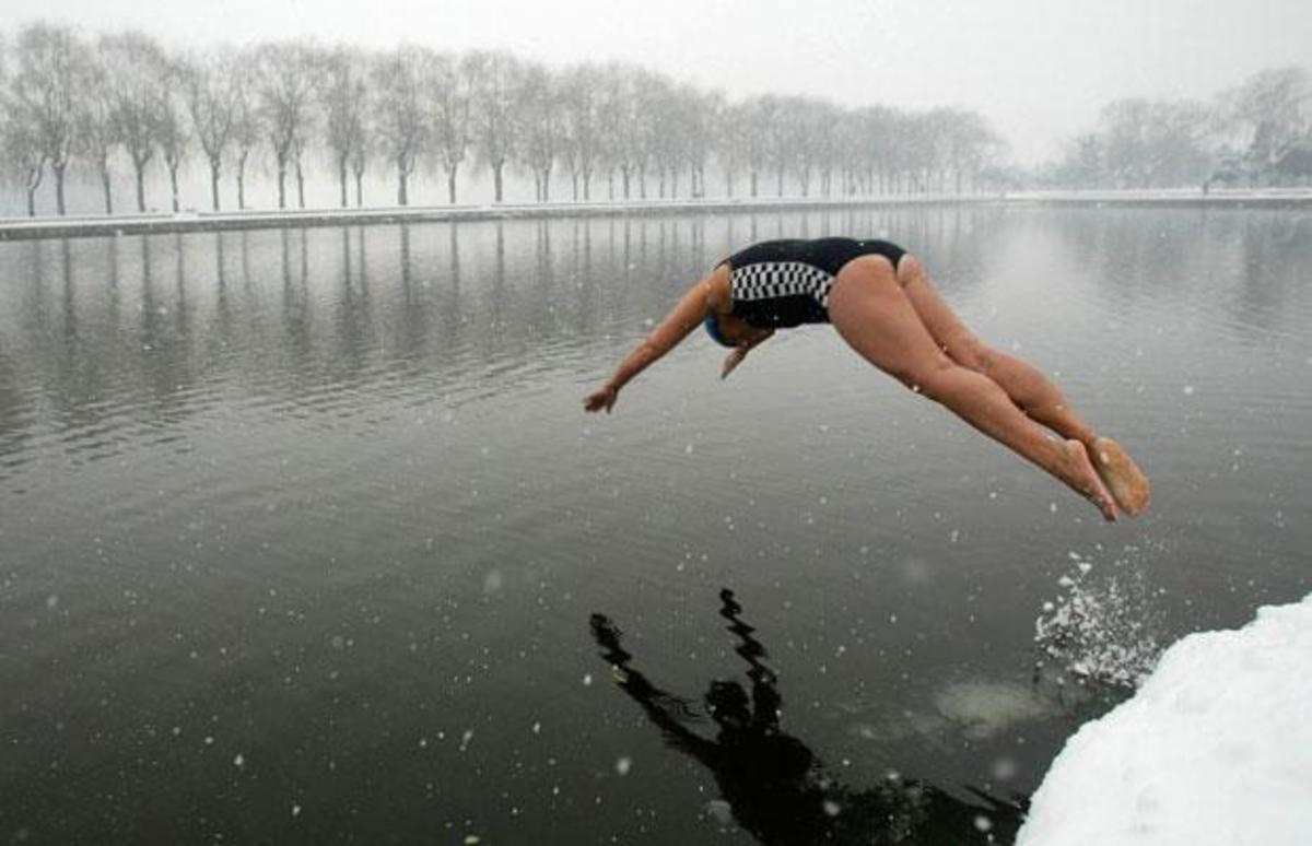 Shenyang, Liaoning province, China - A peaceful dive into icy water.