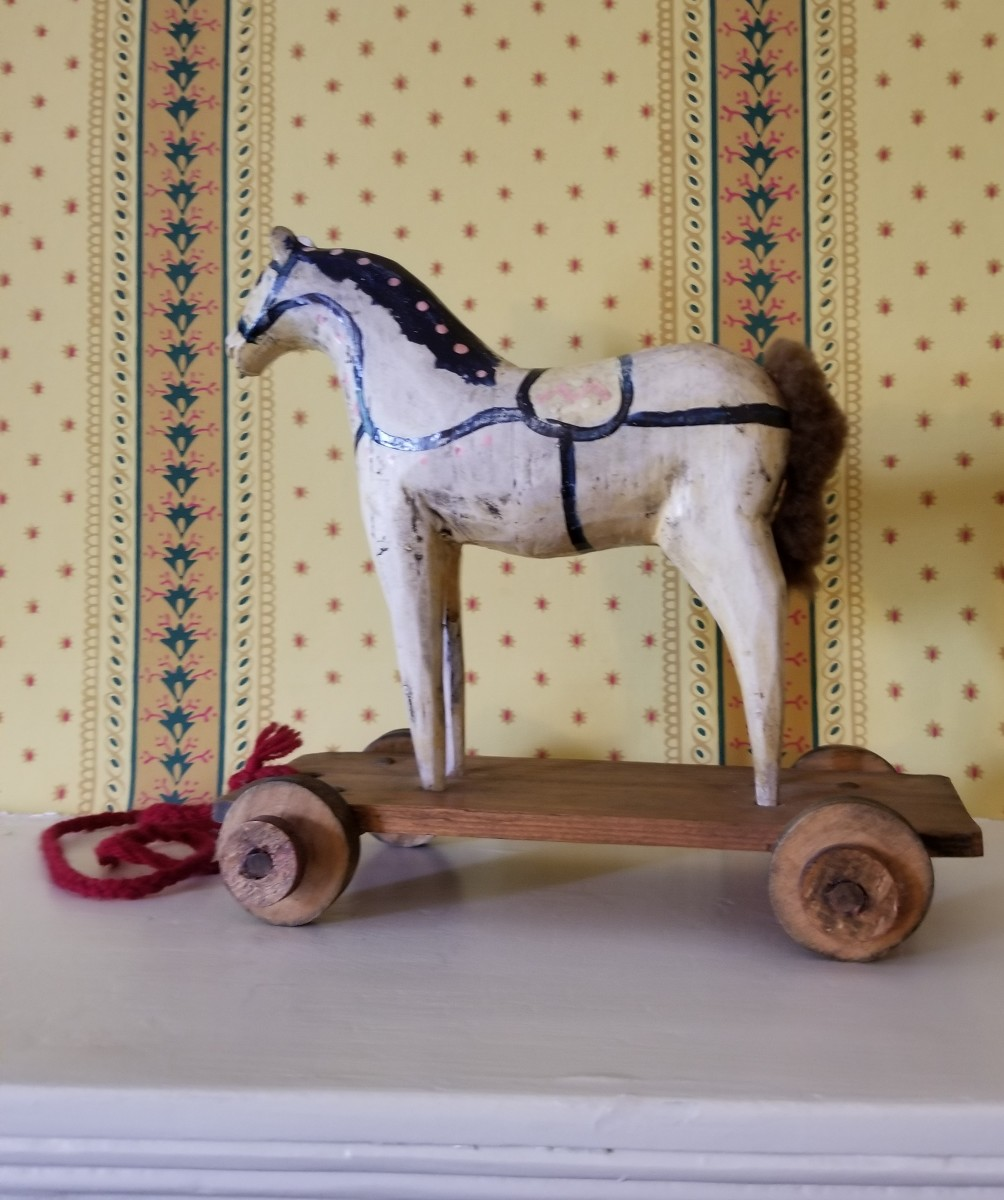 A toy from a store or one carved by a family member. This one is a pull toy, but horses also were made into rocking horses to ride on.