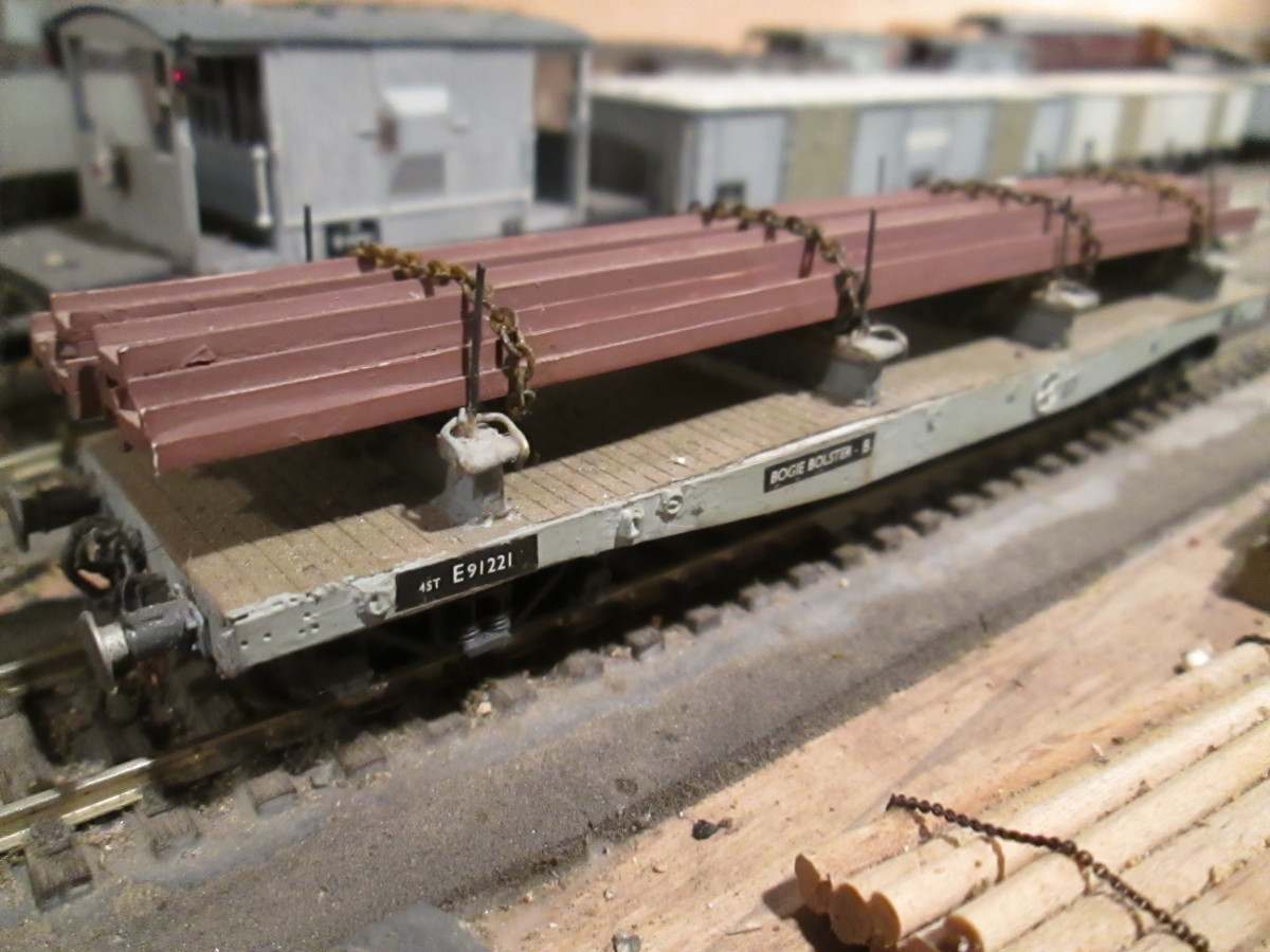 British Railways re-liveried many of the WD Warflats for conversion to carry steel stock and engineering steel from the many steel plants