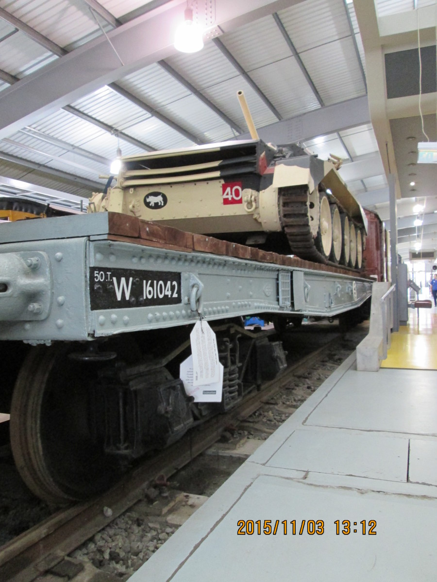 Tank carrying Warflat in BR grey livery, Western Region cypher - Locomotion, Shildon