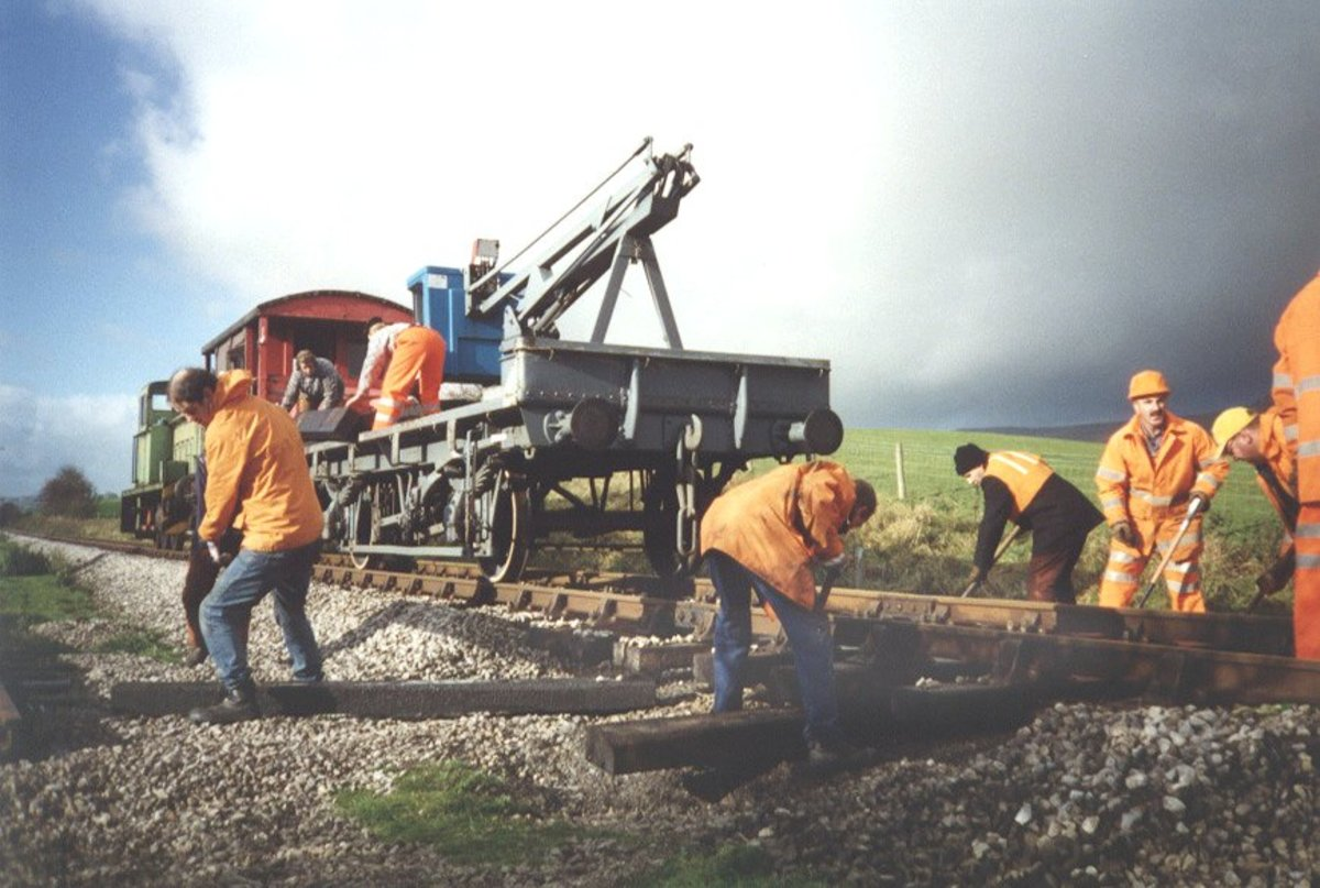 A sleeper wagon-mounted grab crane for replacing and removing sleepers on the Embsay & Bolton Abbey Railway near Skipton, North Yorkshire