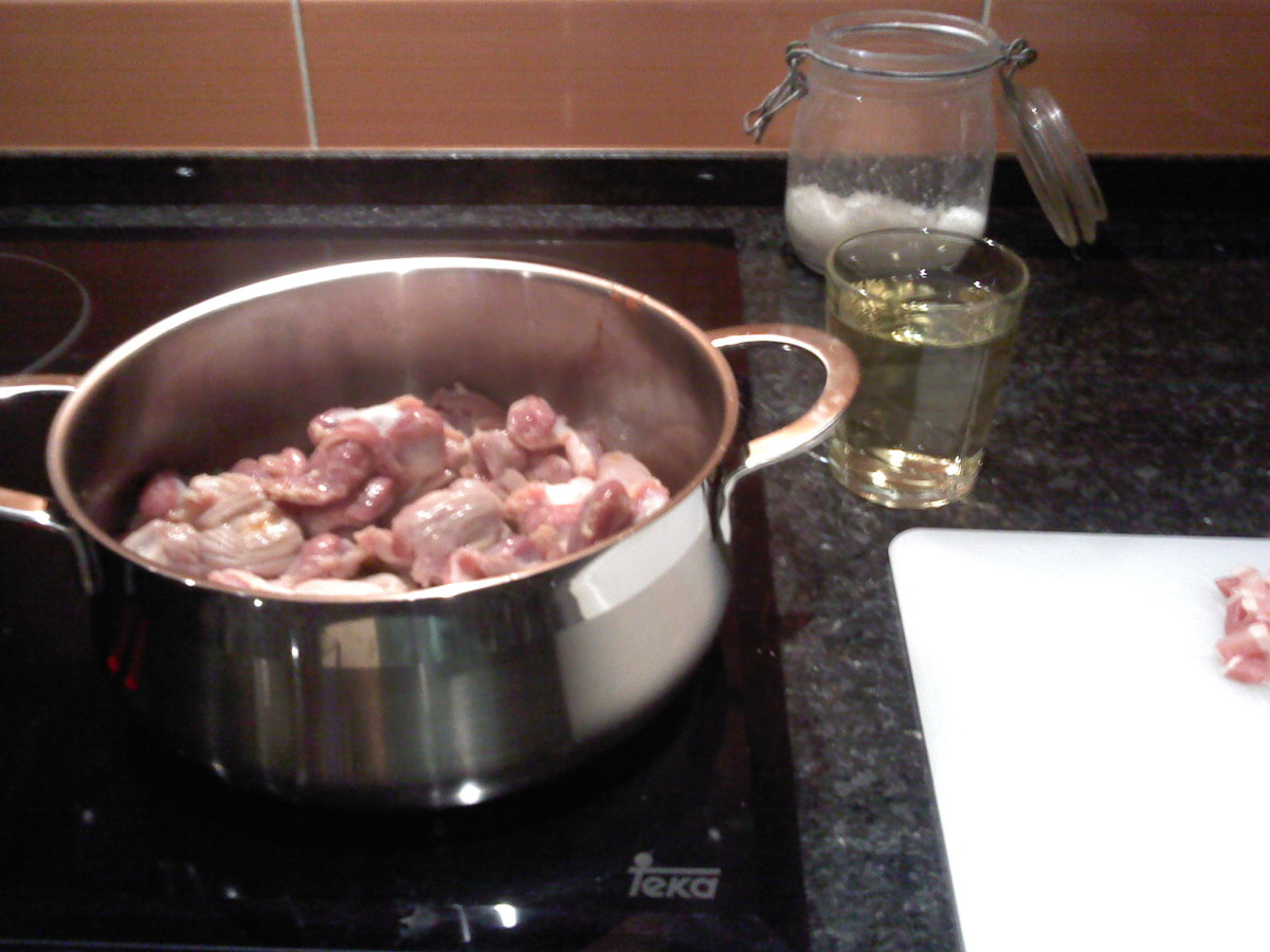Adding the chicken gizzards to the pan