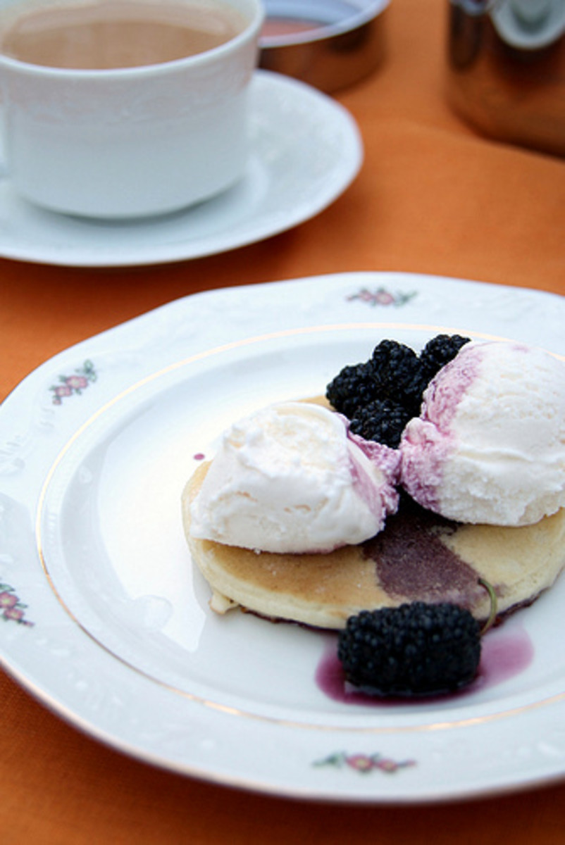 Enjoying syruped mulberries with vanilla ice cream and crumpet.