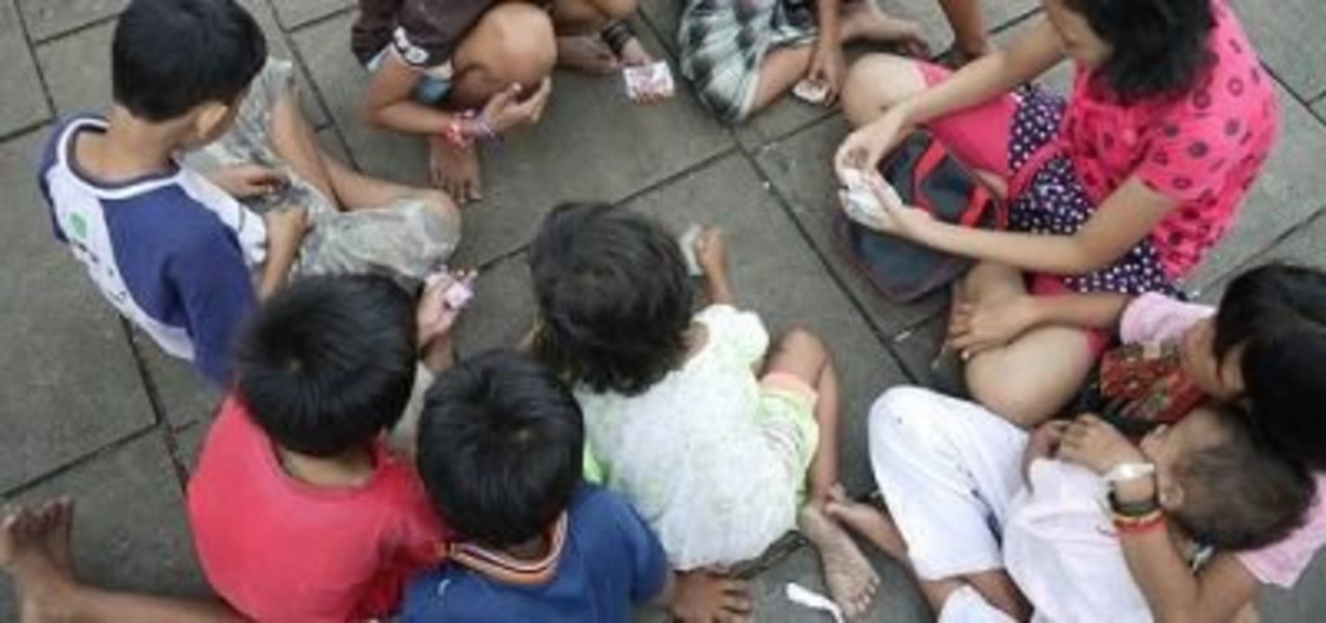 Kids Playing With Play Money On The Street