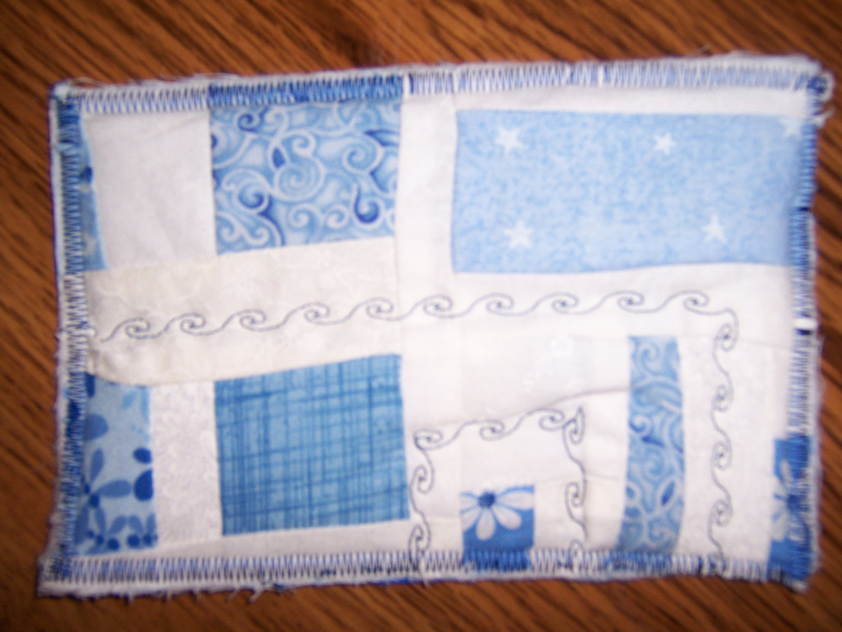 This postcard was made by sewing scraps of fabric together, and using different stitches on the sewing machine for decoration.