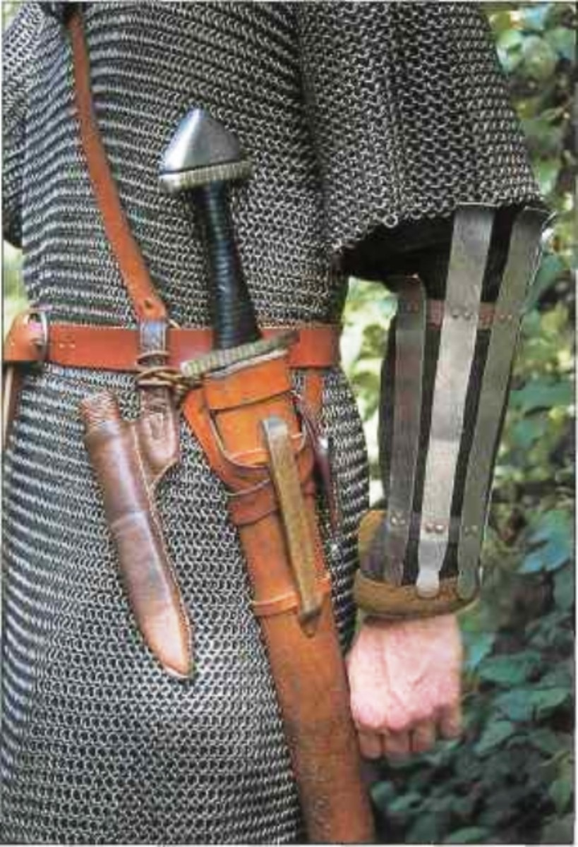 Arm guard and weaponry - the knife seems to be drawn, in the man's right hand