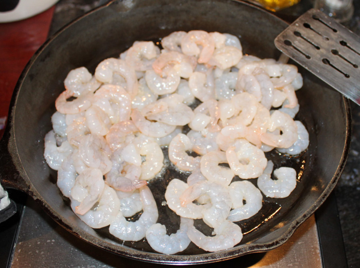Shrimp will start to turn pink within seconds of hitting a hot skillet.