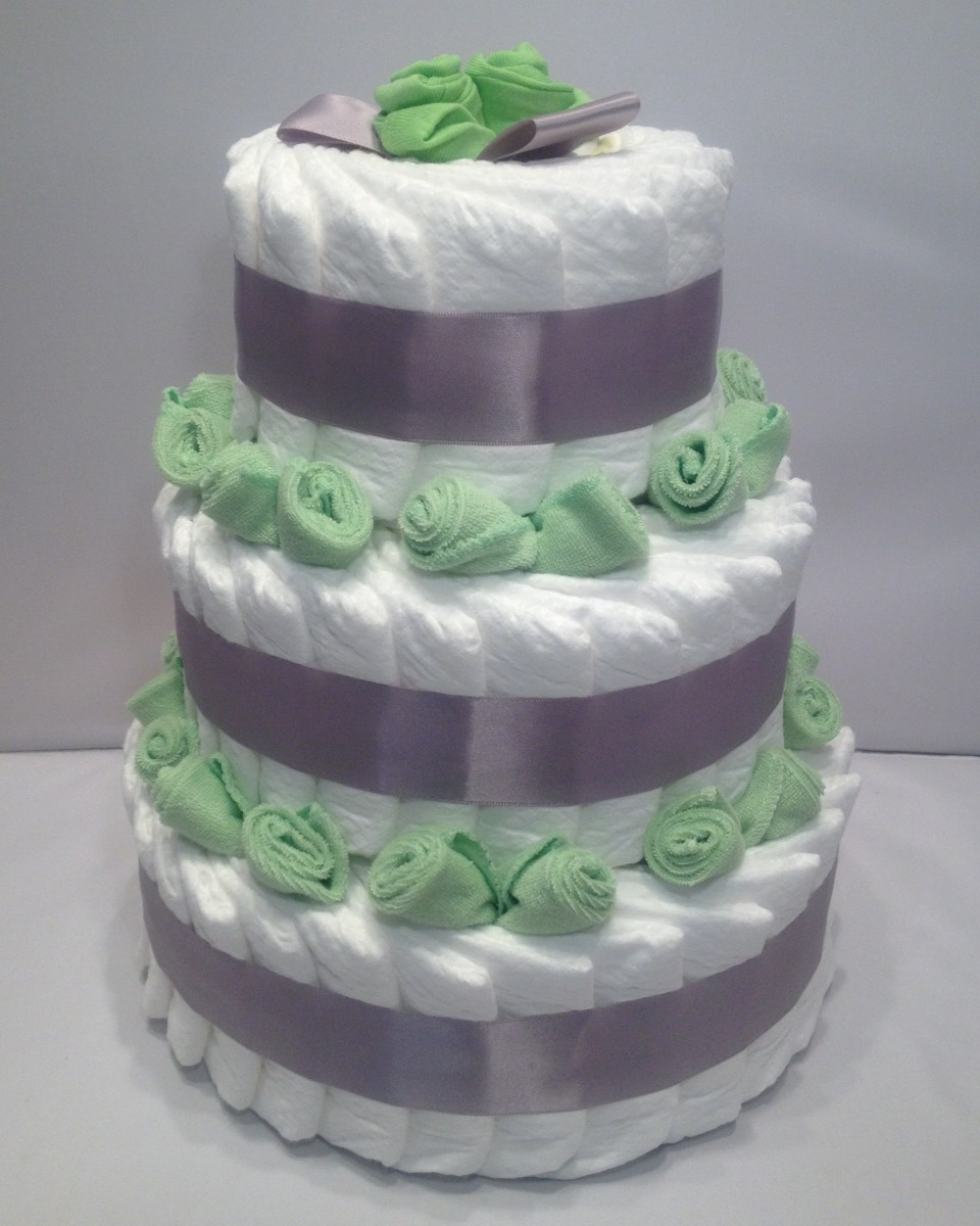 How to make diaper cakes with decorating tips hubpages for Baby shower decoration diaper cake