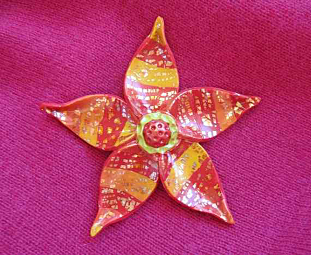 An example of my fun, colorful, inexpensive and easy to make polymer clay fantasy flower pin from my step-by-step jewelry making tutorial.