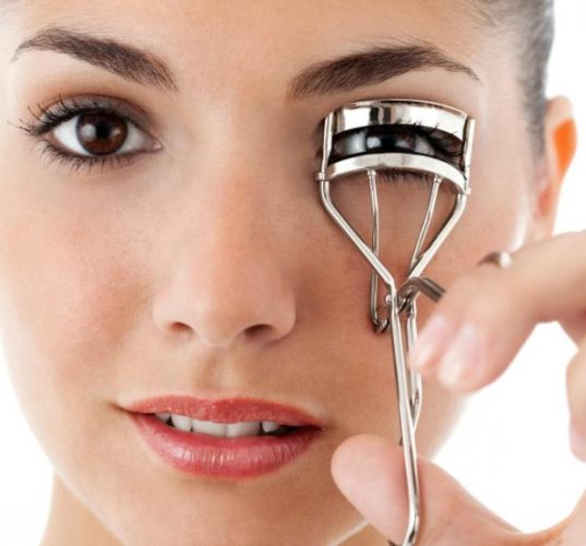 Curling your eye lashes adds an instant lift