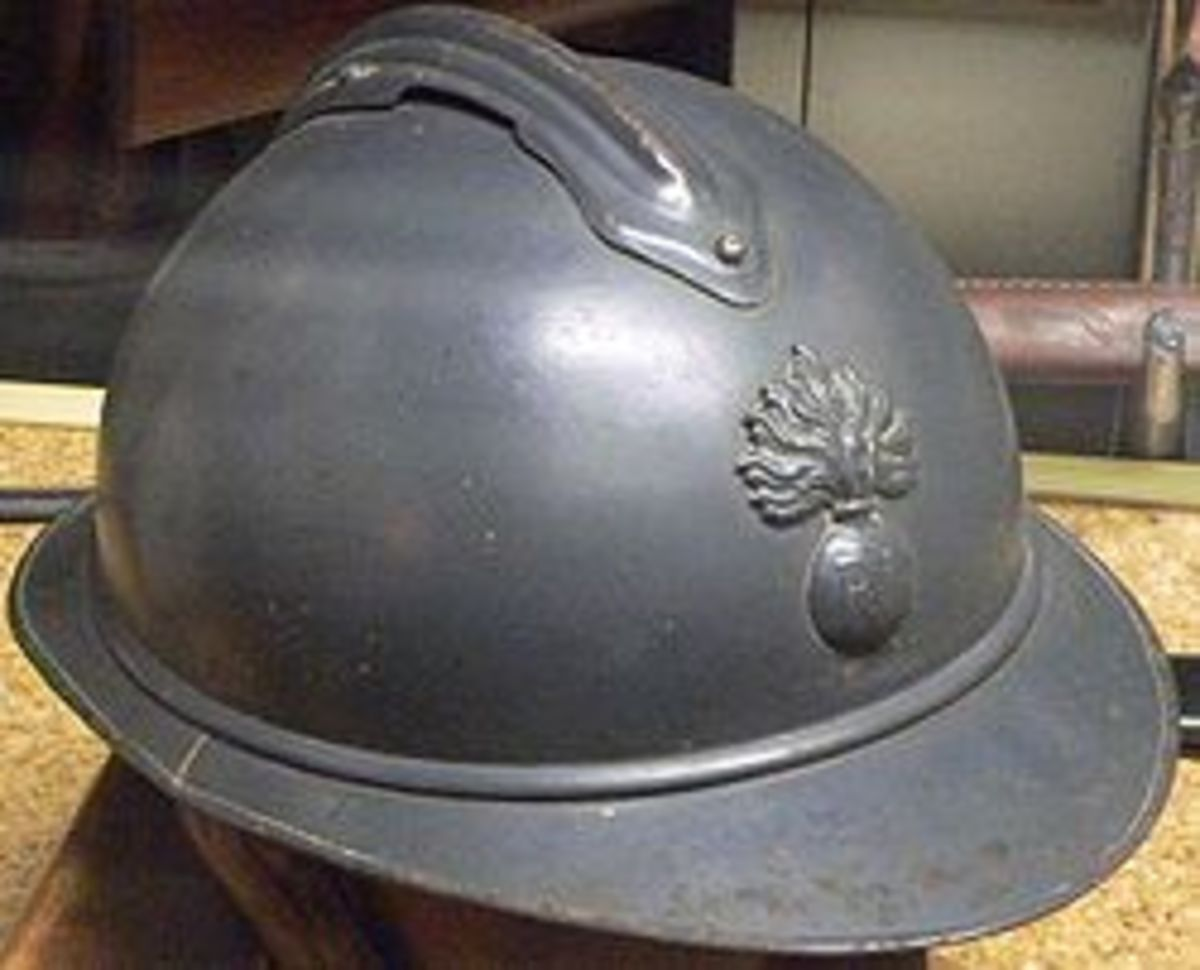 """Adrian helmet, French full head metal helmet introduced in 1915. The """"crest"""" on top is reinforcement to deflect shrapnel from above"""