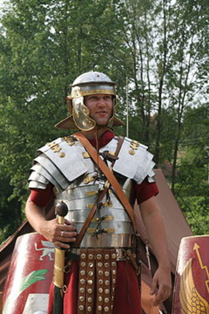 Lorica Segmentata on an re-enactor dressed as a Roman Legionnaire. note the different individual overlapping segments covering shoulders, chest, and stomach