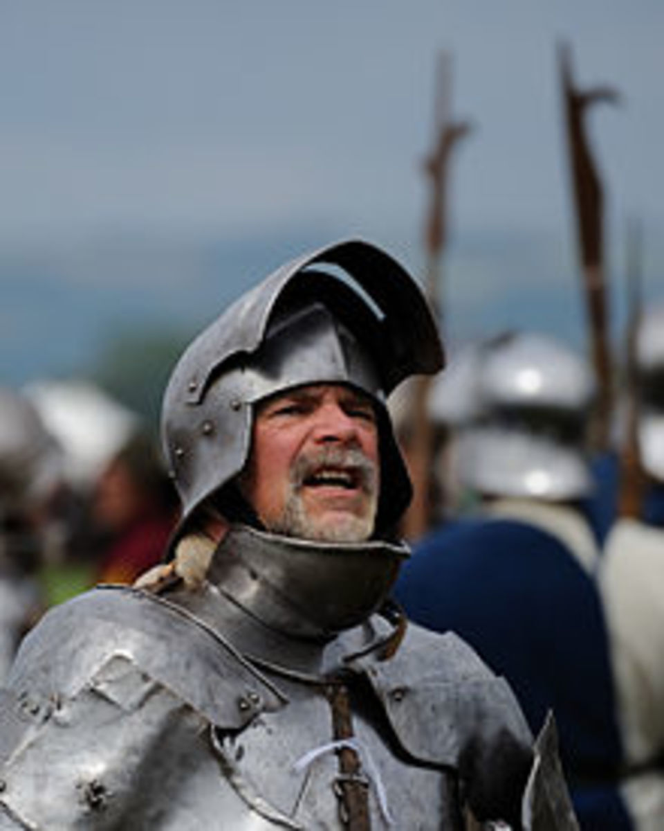 Armor on an re-enactor dressed as a medieval knight, note the full curved plates cover all spots, including throat and armpits.