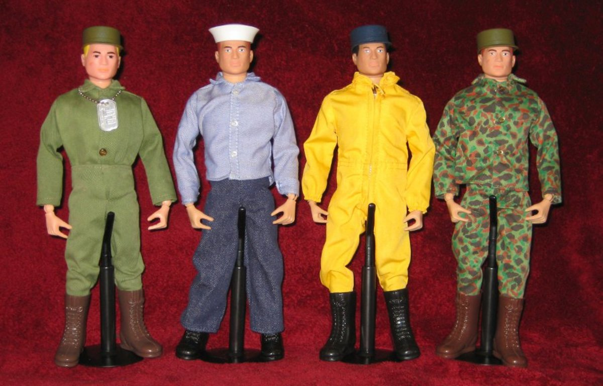 G.I. Joe as he looked straight out of the box in the 1960s. From left to right: Action Soldier, Sailor, Pilot and Marine. The soldier is wearing the dog tag that came with all G.I. Joe figures. The pilot flightsuit came in both yellow and orange.