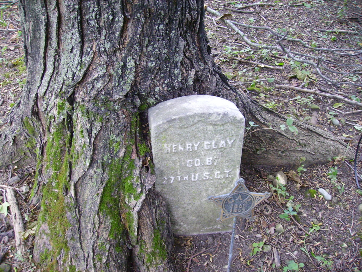 The headstone of Henry Clay of Co. B - 27th U.S.C.T. , with star shaped GAR marker in front.