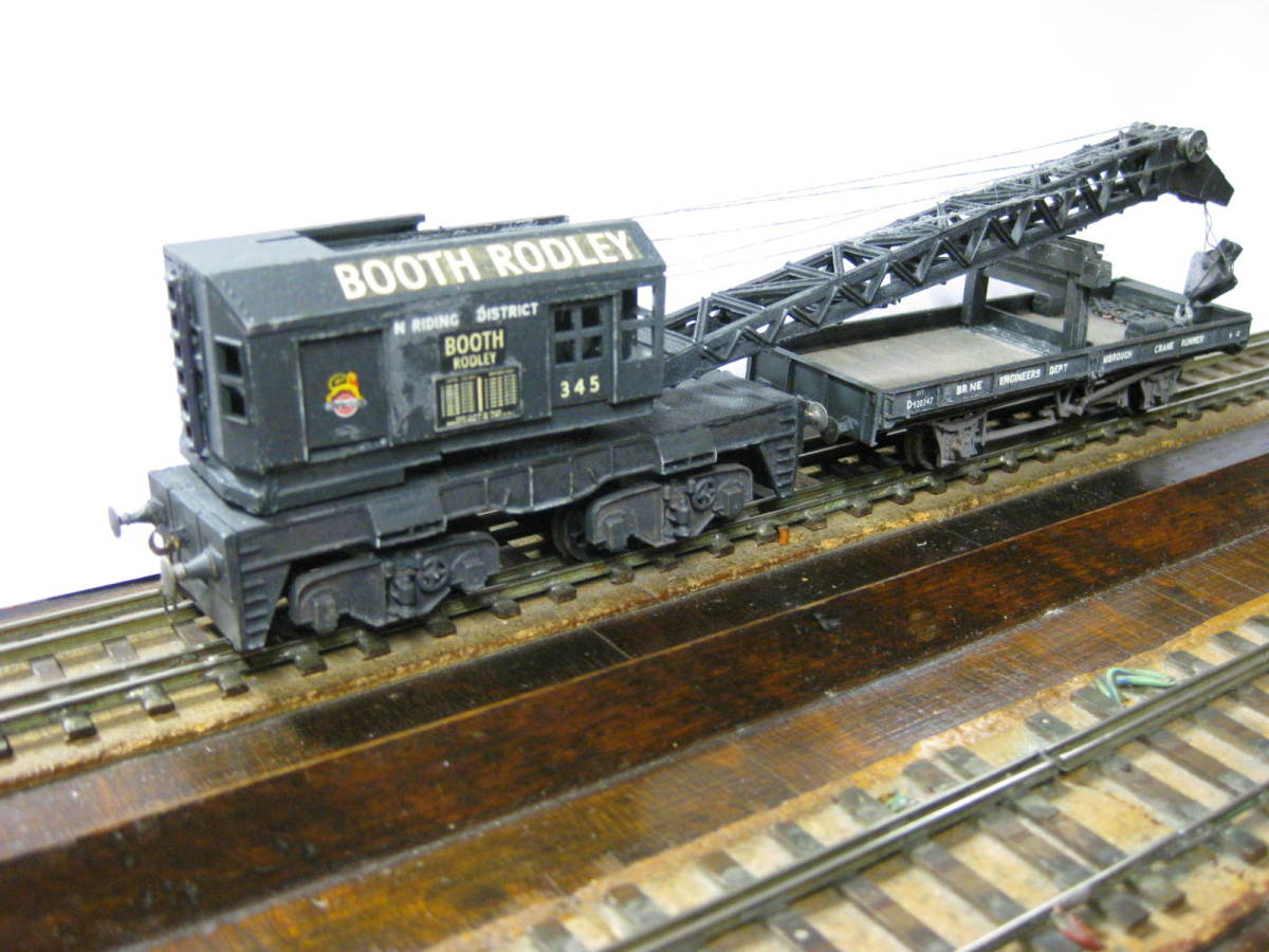 Booth Rodley of  Leeds produced large numbers of cranes for the railways. This is an Airfix/Dapol Bogie Diesel crane I built over several days, taking care not to get adhesive in the working parts. I used grey thread to resemble steel cable.