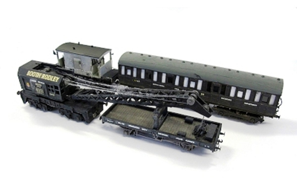 The 'Crane Train', at the back Airfix/Dapol brake van modelled as 'un-fitted' to the left of a modified Ian Kirk kit-built coach (part of a Quad set). Front left is an Airfix/Dapol bogie mounted crane with crane runner, modified Parkside plate wagon