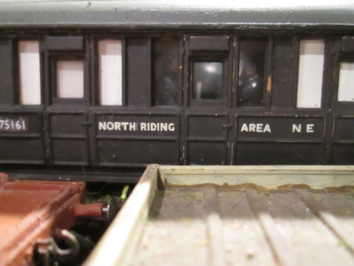 Detail: Close-up of the engineer's mess coach - re-working of an Ian Kirk quad-art body with Gresley bogies and short underframe trussing (taken across a condemned plate wagon)
