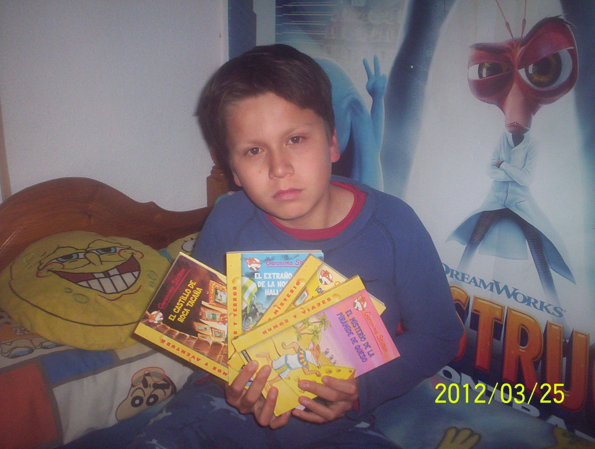 my son showing some of his Geronimo Stilton Books