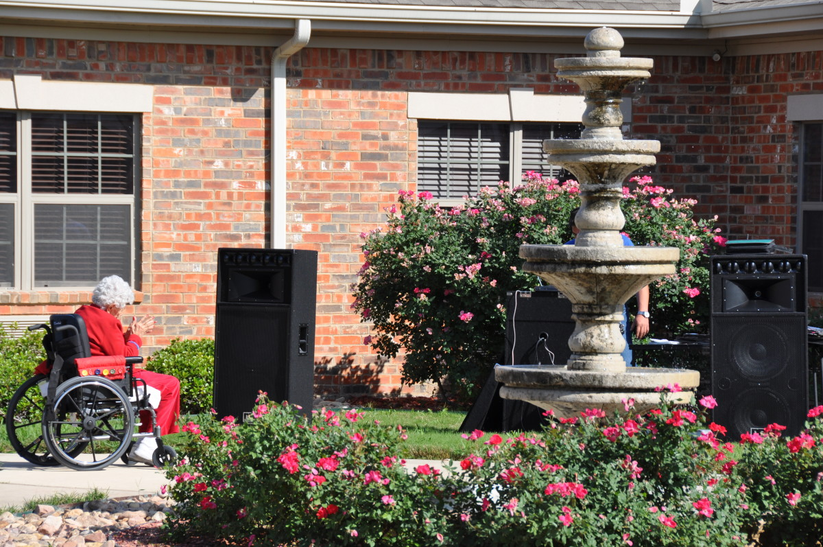 San Antonio nursing home/long term care facility with fountain and beautiful landscaping.  Notice they are setting up for music entertainment!