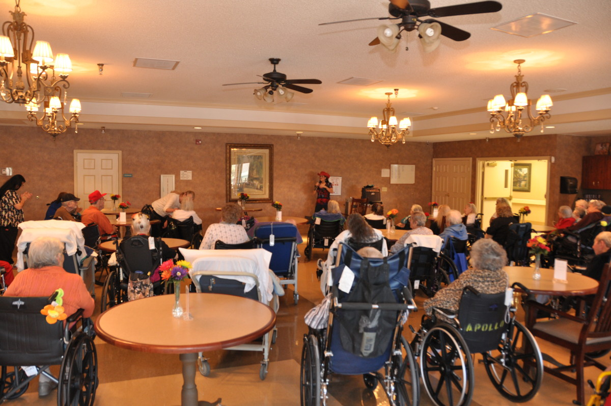 Nursing home residents enjoying musical performance