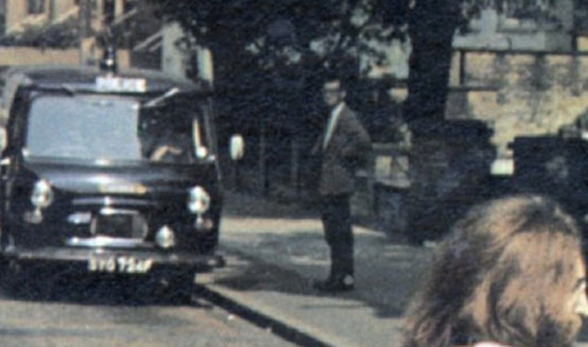 Paul Cole next to the police car