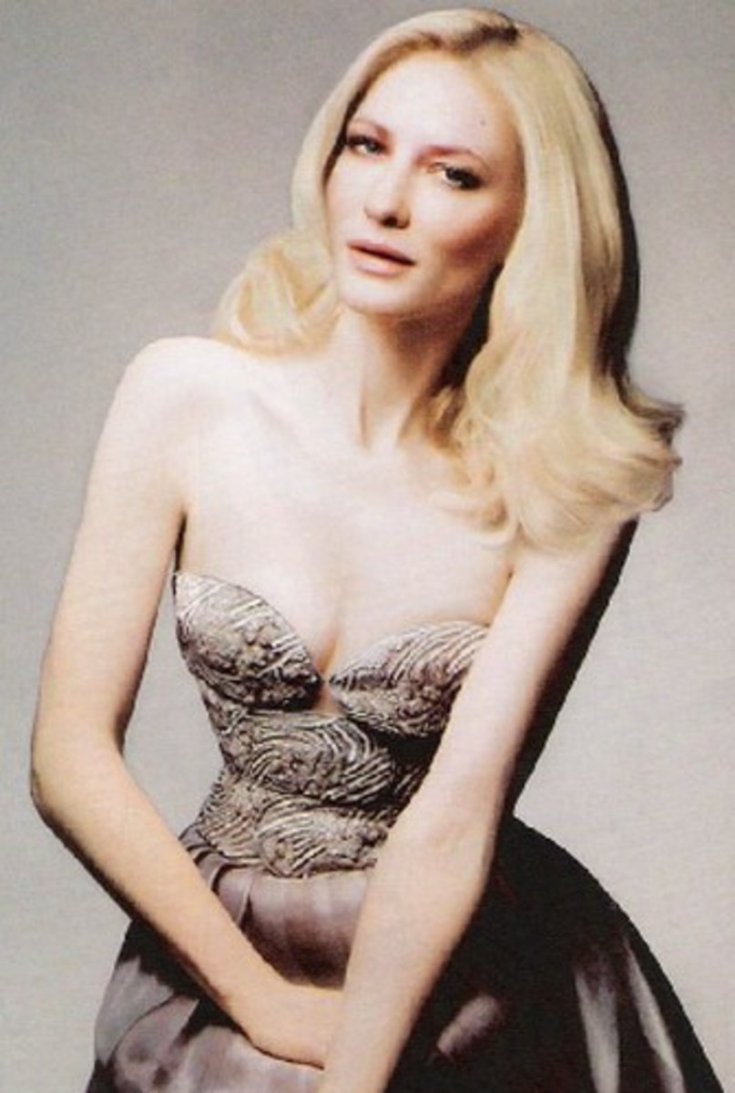 Cate Blanchett with light blonde hair, pale skn, and a silver dress