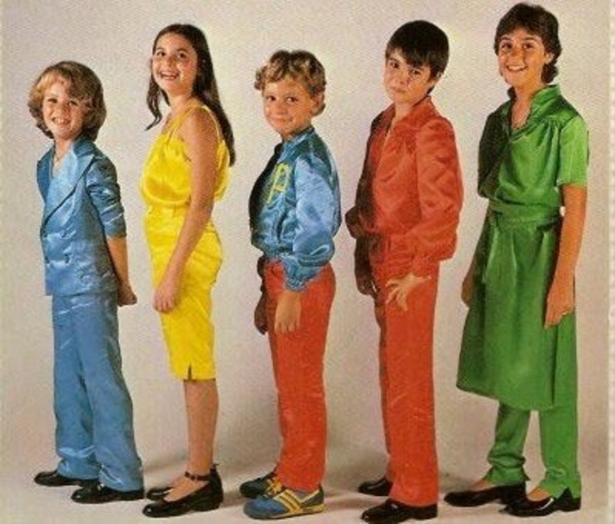 The childrens group Parchis is composed of four generations. This picture shows the members of the first generation: Tino Fernandez was the red chip, Yolanda the yellow, chip, Gemma Pratt the green chip, David Munoz was the Dice (the middle boy) and