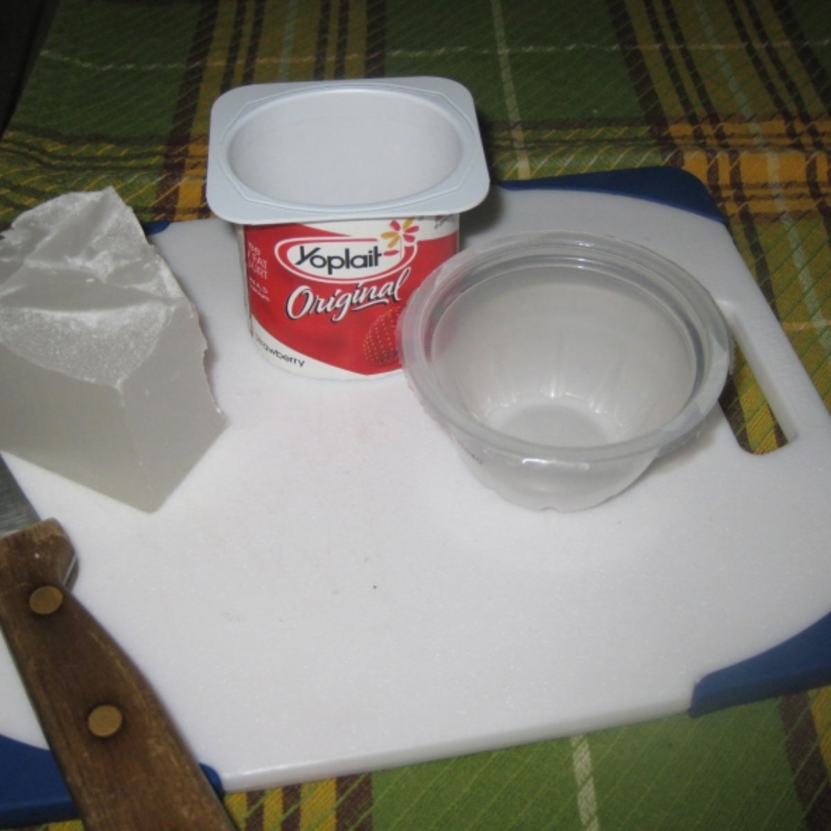 A yogurt container and a fruit cup ready for candle making.All photos shown here by Peggy Hazelwood.