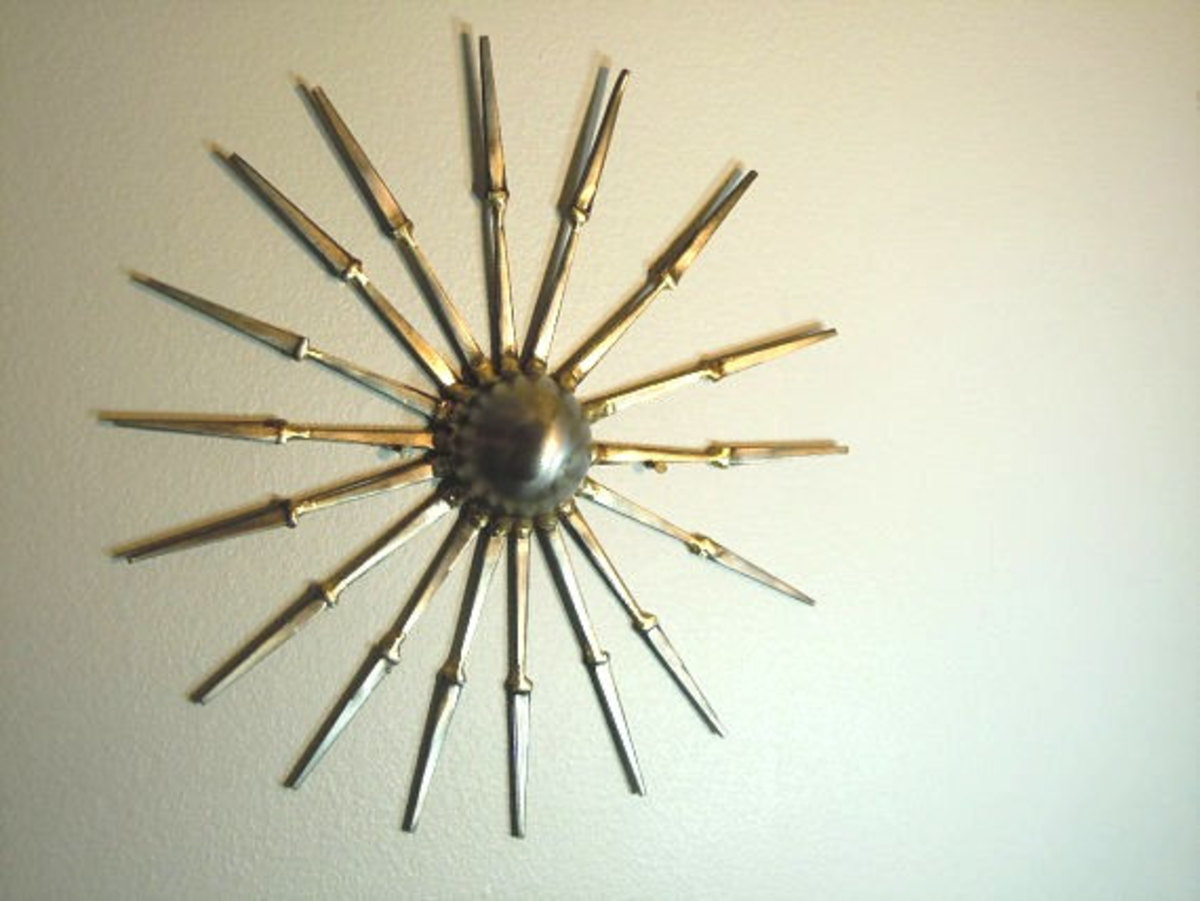 A mid century sunburst made from cut nails and a pipe endcap