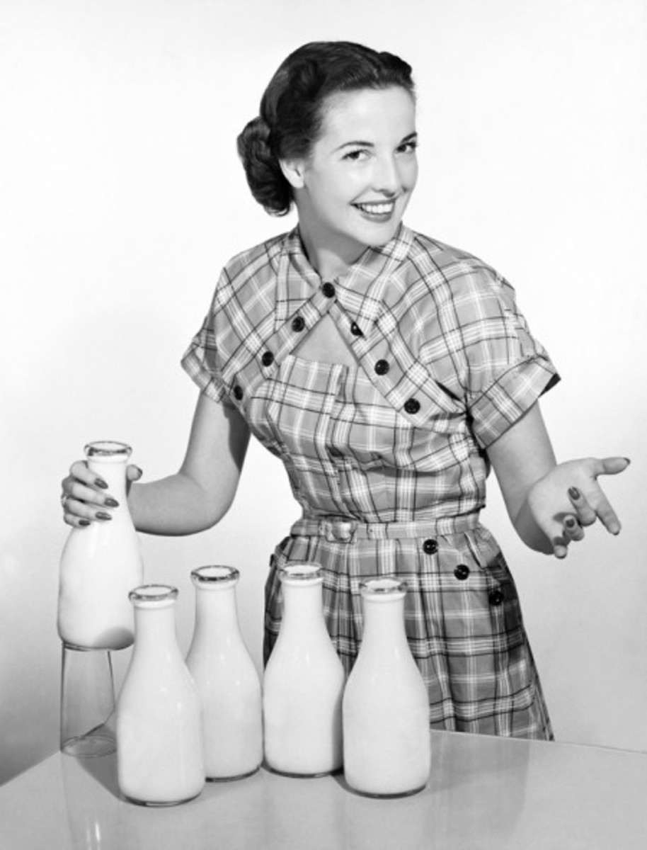 A happy fifites housewife with milk courtesy of Velma's Retro Clip Art and Images.See the link below to download this retro clip art.