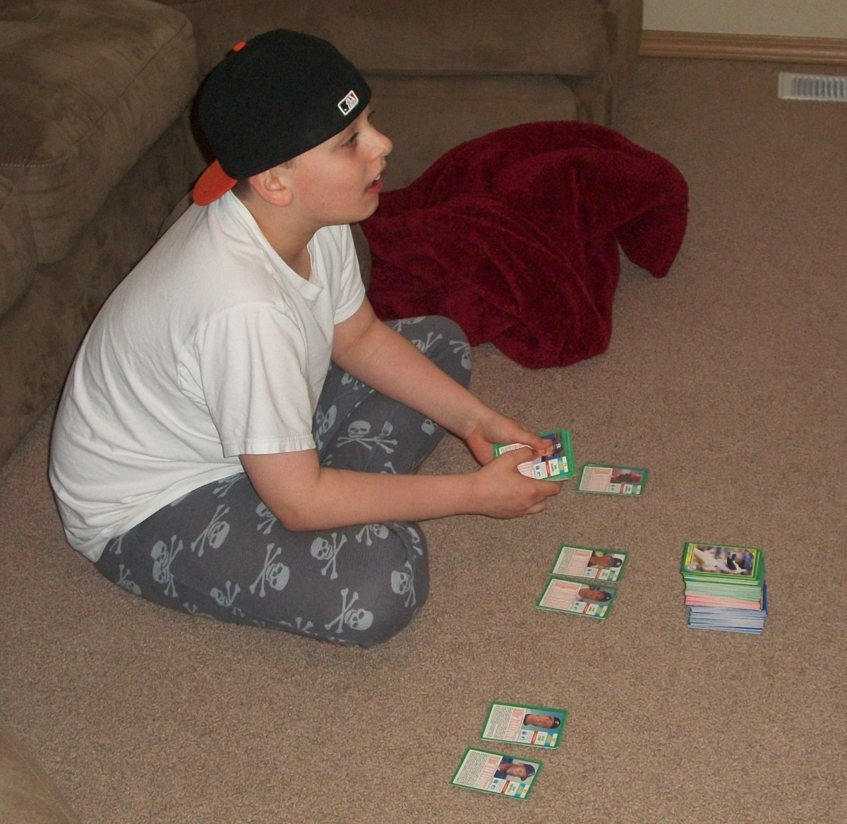 Young boy with Asperger's organizing baseball cards