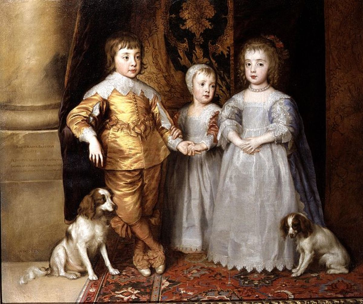 Oil portrait of Young King Charles II of England with his spaniels, the Cavalier King Charles Spaniel.