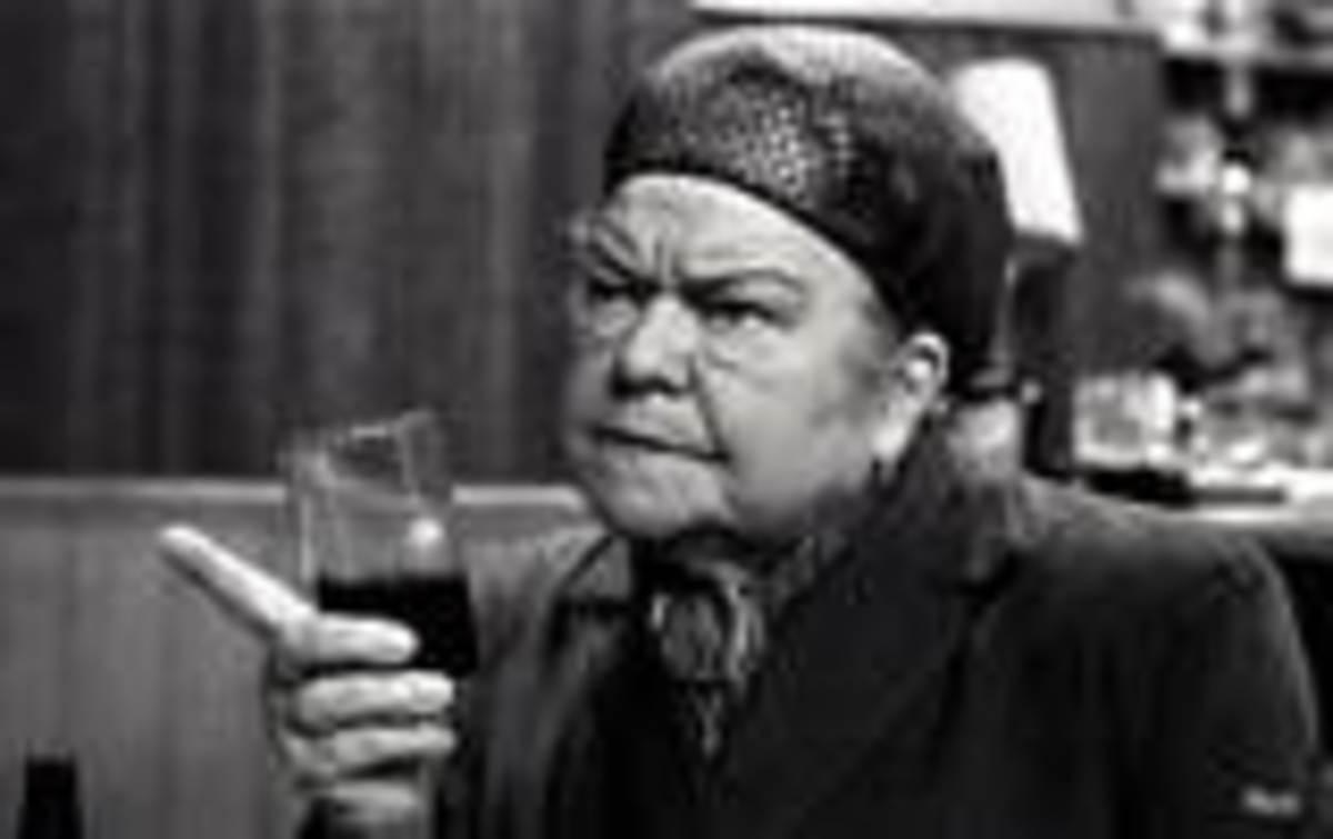 Ena Sharples drinking a half of black and tan.