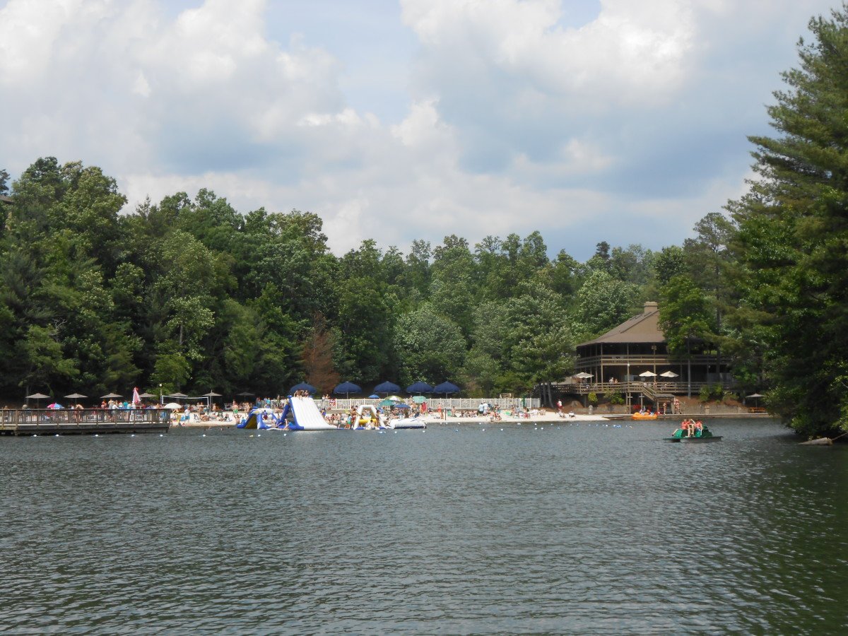 View of the lake with inflatables. There are also paddle boats and canoes to use.