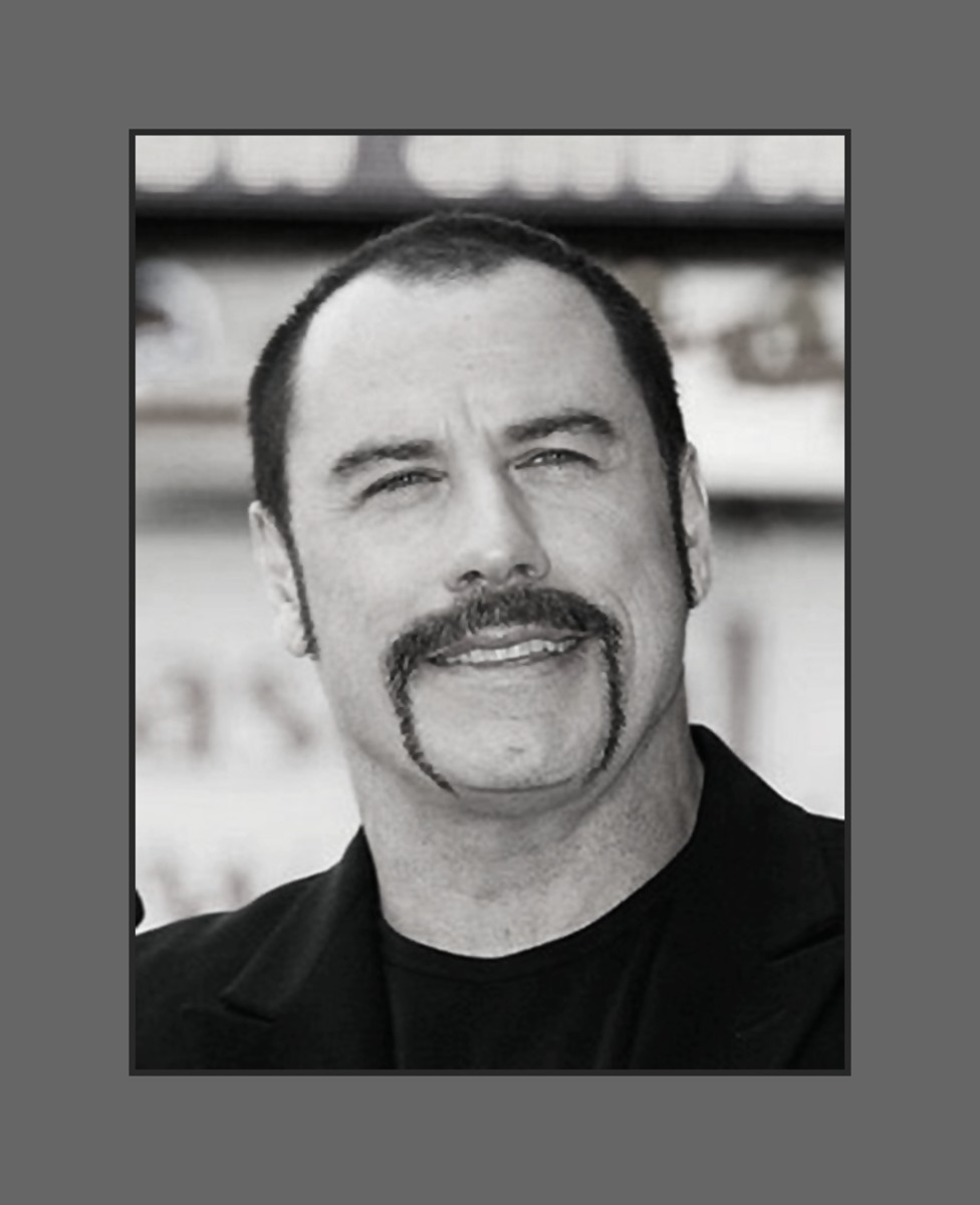 John Travolta has embraced his baldness and opted for buzz cut with a fu manchu mustache - 2013 Hairstyles for Men with Balding Thinning Hair Style Cuts Trends