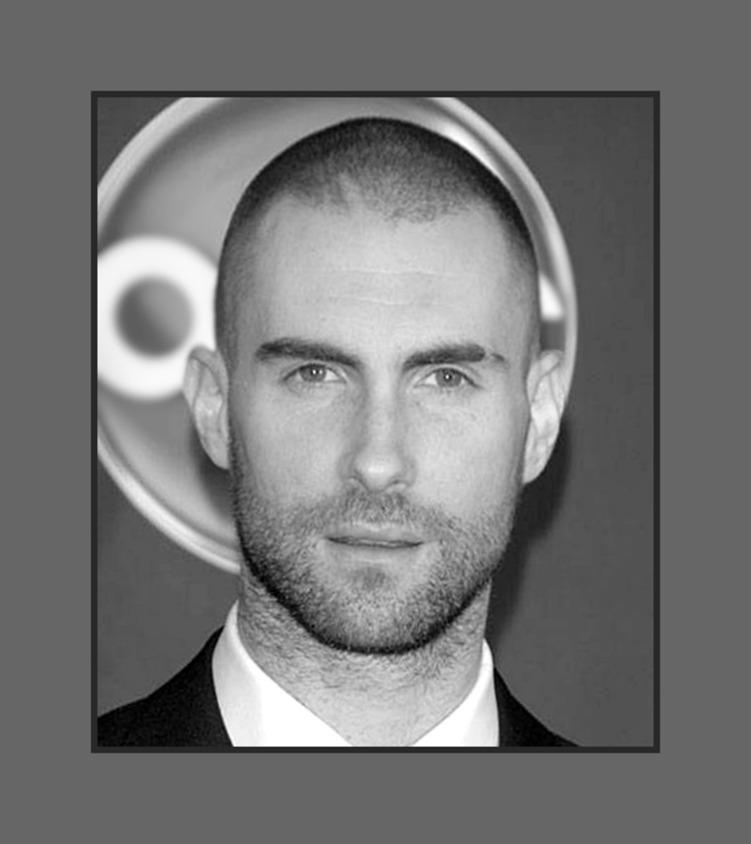 Adam Levine turned to buzz cut for change.  His awesome hairline is receding, but that doesn't take away an iota of his sex appeal.  Adam is so cool with his buzz cut. - 2013 Hairstyles for Men with Balding Thinning Hair Style Cuts Trends