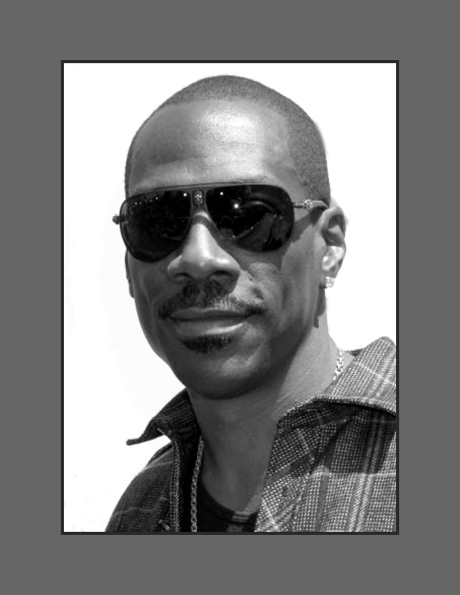 Eddie Murphy chose the buzz cut hair style to take away the focus on his thinning hair and receding hairline. - 2013 Hairstyles for Men with Balding Thinning Hair Style Cuts Trends