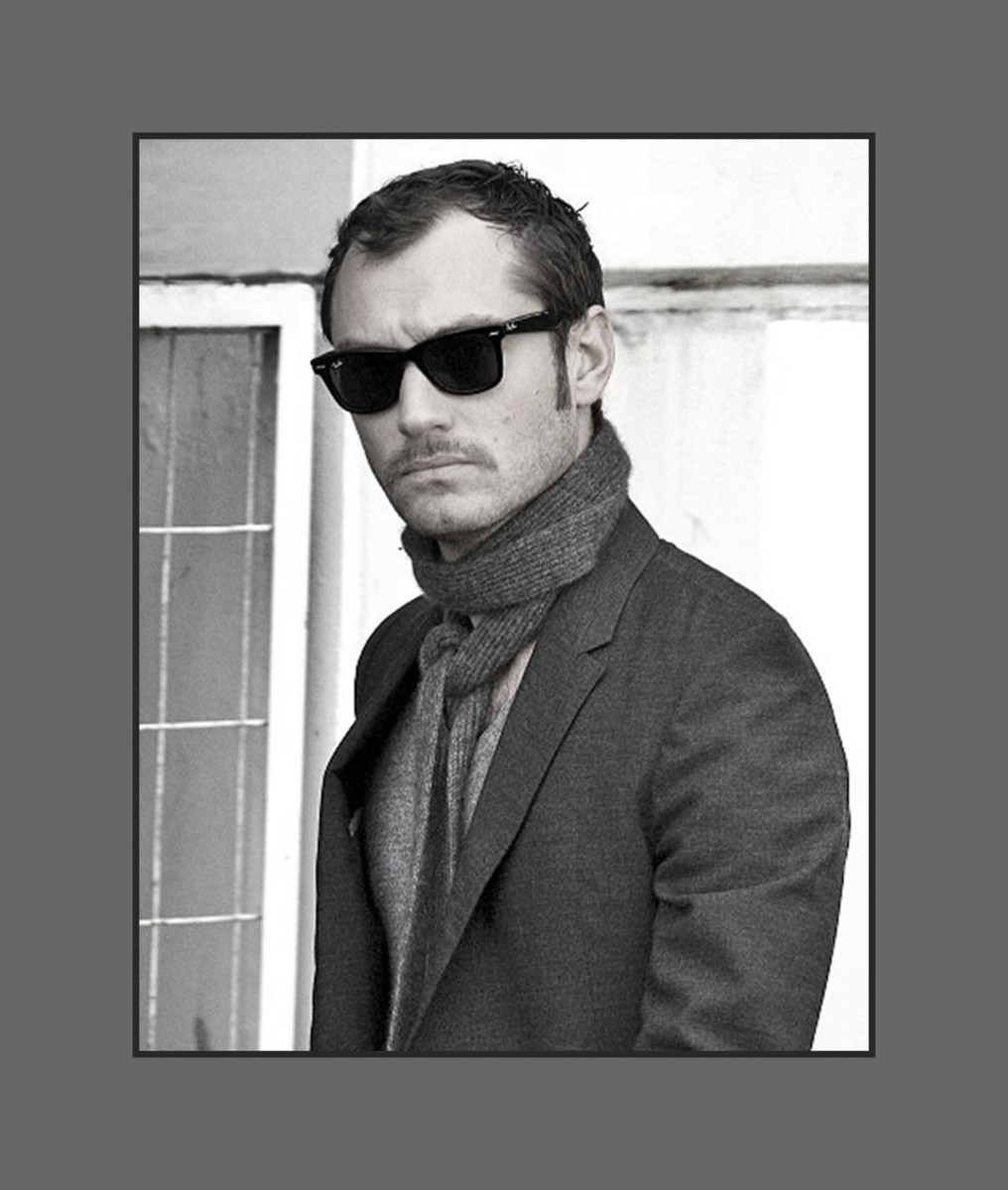 Jude Law's hair is cut short layered all over with long thin sideburns, styled flat giving a bold look - 2013 Hairstyles for Men with Balding Thinning Hair Style Cuts Trends