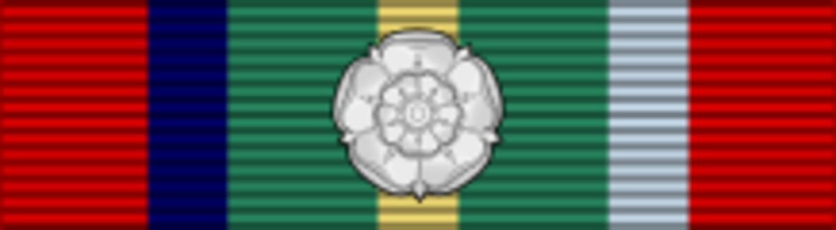 Silver rosette, worn when a soldier wears his medal ribbon without the medal.