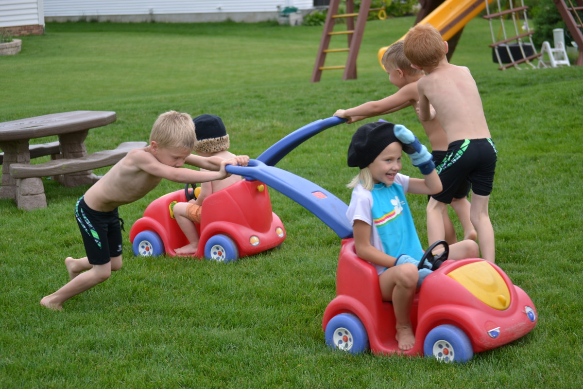 Pushing Kids In Baby Cars Relay Race