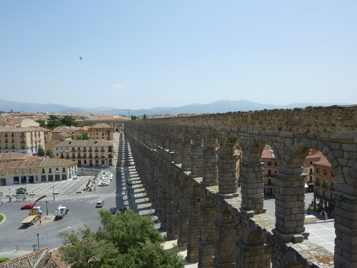 Aqueduct of Segovia: this ancient water channel cuts through the modern aspects of the city, perhaps representative of an age-old conflict splitting the consciousness of the current people